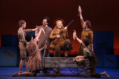 Clockwise from Center: Deborah Voigt as Annie Oakley, Lauren Snouffer as Minnie, Richard Pittsinger as Little Jake, Addy Schneider as Jessie, Maria Pittsinger as Nellie and Peter Macklin as Foster Wilson in The Glimmerglass Festival's production of Annie Get Your Gun. Photo: William Brown.