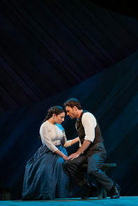 """Andrea Carroll as Julie Jordan and Ryan McKinny as Billy Bigelow in The Glimmerglass Festival's 2014 production of Rodgers and Hammerstein's """"Carousel."""" Photo: Jessica Kray/The Glimmerglass Festival."""