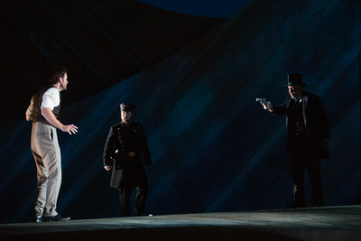 """L to R: Ryan McKinny as Billy Bigelow, Andrew Penning as 2nd Policeman and Drew Taylor as David Bascombe in The Glimmerglass Festival's 2014 production of Rodgers and Hammerstein's """"Carousel."""" Photo: Karli Cadel/The Glimmerglass Festival."""
